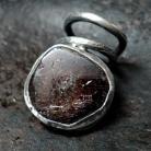 Pierścionki Masywny zawijany pierścionek z granatem